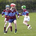 Captain, Eoghan Gately launches another attack, with Charlie Keher in close attendance.